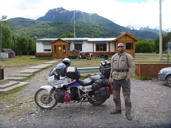 Mike gets serious for the crossing into Chile (Futaleufú), frightening onlooking backpackers waiting for a ride