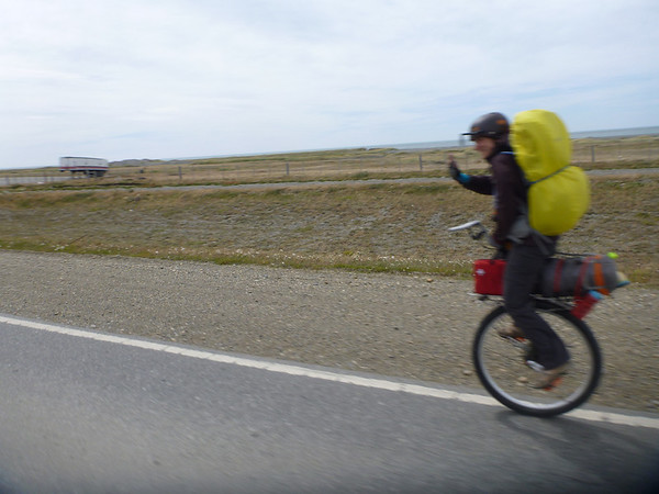 unicyclist on her way, Tierra del Fuego