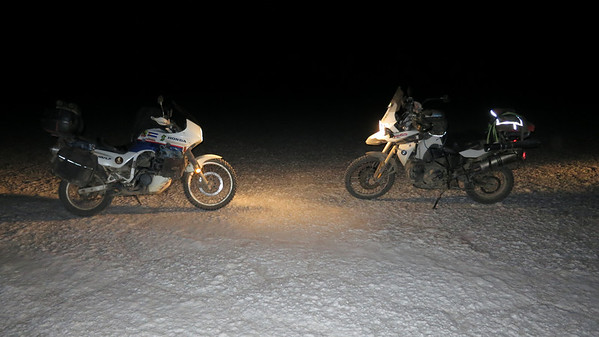 The TA and BMW spotlighting each other during a midnight ride across the Salar