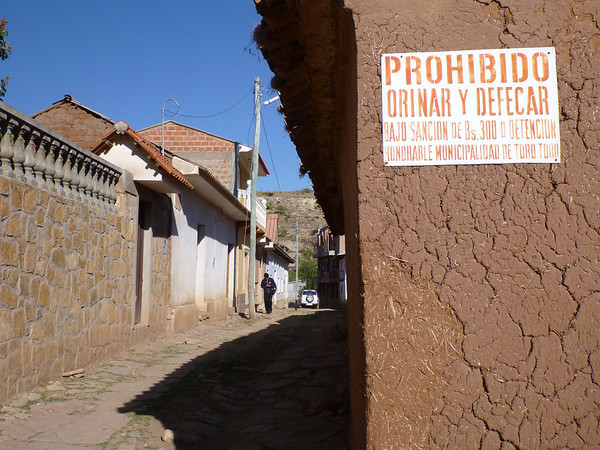 I know public urination happens against any standing wall in Latin America, but apparently they had to warn people about #2 too.  (Torotoro)