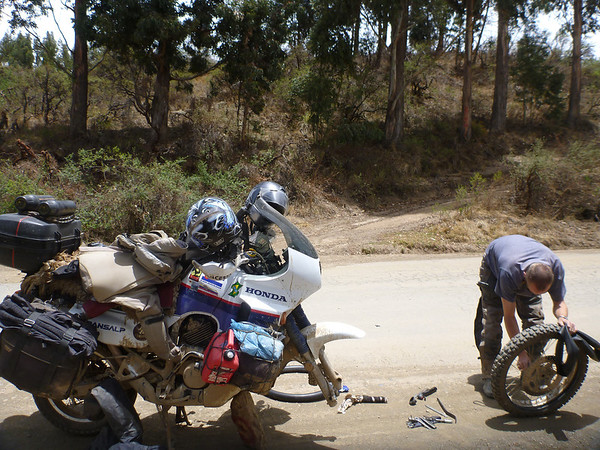 Mike repairing a flat on the way to Vallegrande.