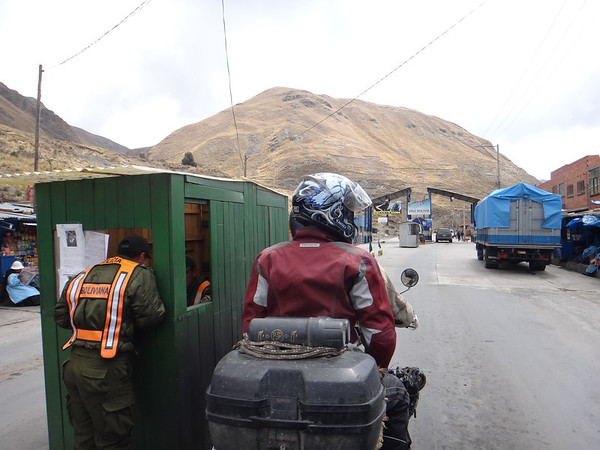 Checkpoint on the way to the Death Road.  They wanted to see our DL, but mine was buried.  Mark showed his and that was sufficient for all.  The toll booth waved us through, which happened in La Paz, and all over northern Bolivia, until we were between Uyuni and Sucre - they made us pay.