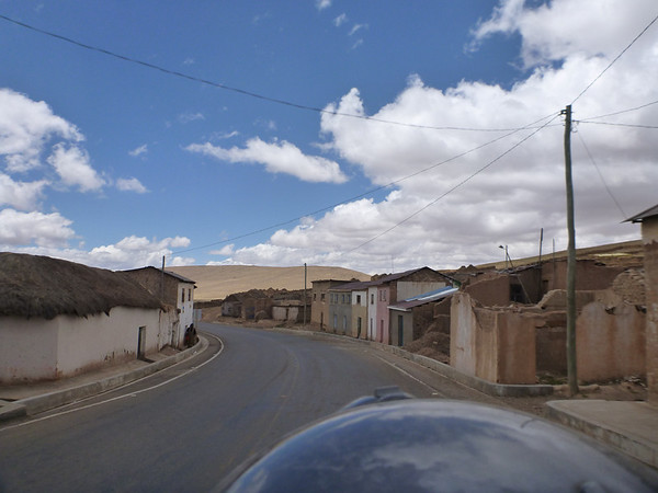 Riding through a town on the way to Uyuni