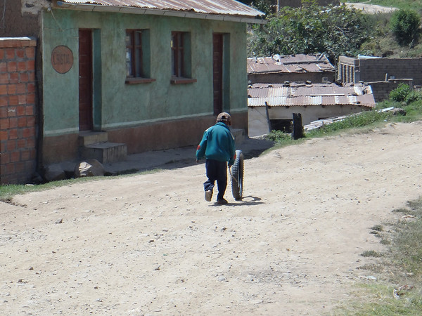 kid playing with a moto wheel, Quime, Yungas (Mark took this shot, we're not fast enough on the draw to get stuff like this)