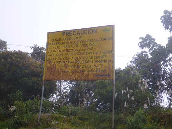 Warning sign at entrance to the Death Road.  The rule of the road was to yield way to the fully loaded mining trucks, also letting them have the hillside-line.  So you were supposed to stay on the cliff side heading  this direction (down)