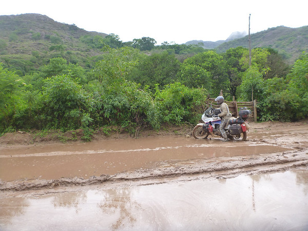 Mike trying to work his way through some very deep mud on the way to the Bolivian border.