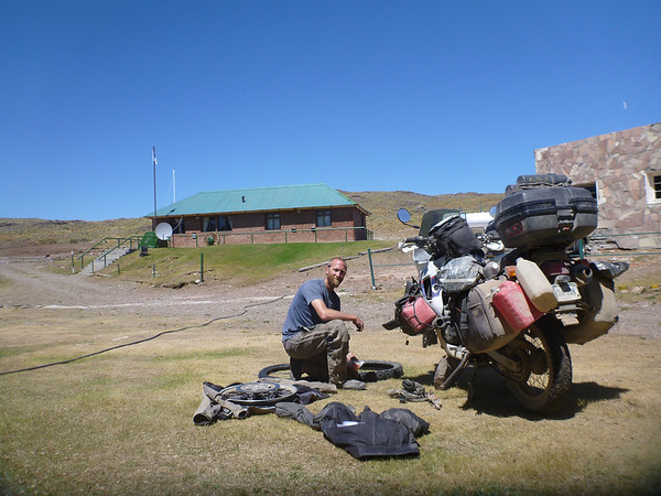 Mike changing the tire at Paso Roballo on the Argentine side.