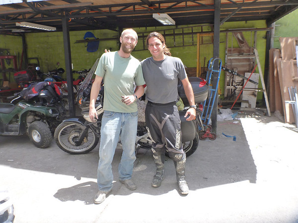 Mike with a fellow moto traveler Mauricio from Spain at the shop in La Serena.