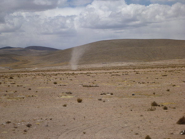 it was windy, and super gusty, on the way to Puno.  dust devil pictured here