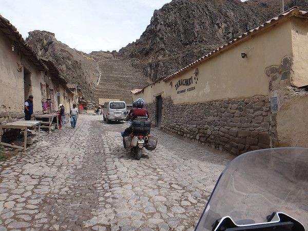 Riding through Ollantaytambo, with ruins immediately ahead