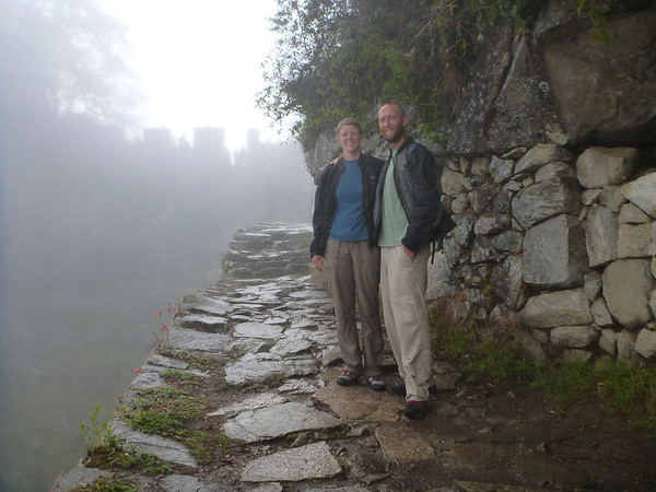 Us at Machu Picchu, walking up to the Sun Gate at daybreak