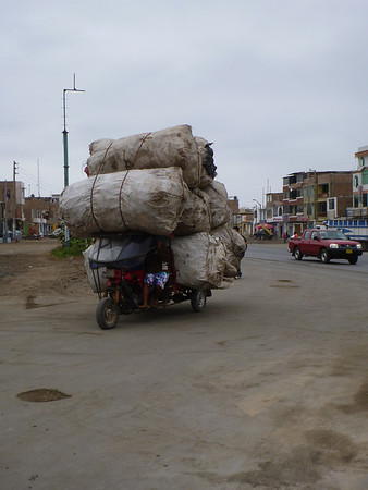 Loaded down mototaxi in Chao, Peru
